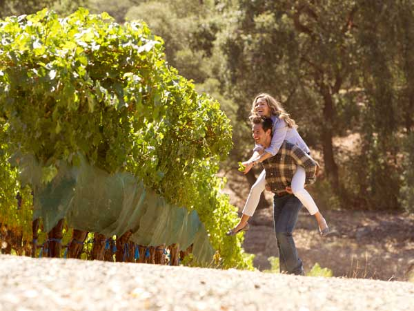Couple Piggyback Ride in Napa Vineyard